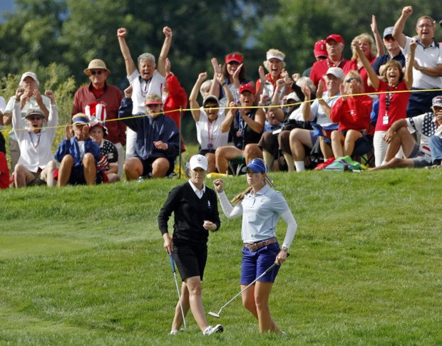 Team USA's Paula Creamer, right, reacts in front of Team Europe's Janice Moodie of Scotland after making a putt on the fifth hole during a foursome match at the Solheim Cup golf tournament Friday, Aug. 21, 2009, at Rich Harvest Farms in Sugar Grove, Ill.