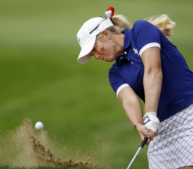 Team USA's Brittany Lincicome hits out of a bunker on the fourth hole during a four-ball match at the Solheim Cup golf tournament Saturday, Aug. 22, 2009, at Rich Harvest Farms in Sugar Grove, Ill.