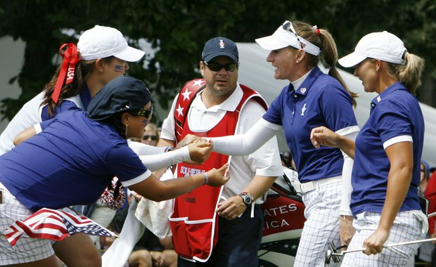 Team USA's Michelle Wie, left to right, and Christina Kim congratulate Angela Stanford and Brittany Lang on the 14th hole during a four-ball match at the Solheim Cup golf tournament Saturday, Aug. 22, 2009, at Rich Harvest Farms in Sugar Grove, Ill.