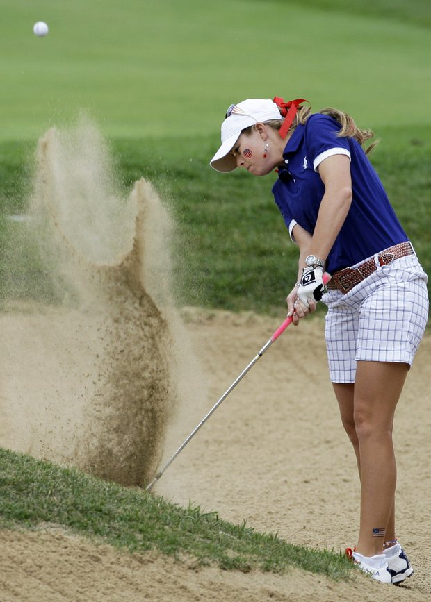 Team USA's Paula Creamer hits out of a bunker on the 10th hole during a foursome match at the Solheim Cup golf tournament Saturday, Aug. 22, 2009, at Rich Harvest Farms in Sugar Grove, Ill.