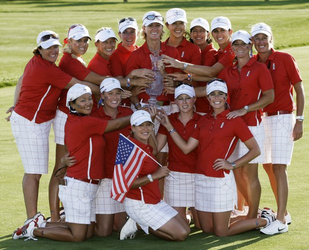 Team USA poses with the Solheim Cup after the golf tournament Sunday, Aug. 23, 2009, at Rich Harvest Farms in Sugar Grove, Ill. The USA team won 16-12 to retain the cup.