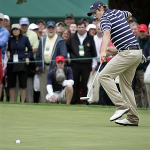 Peter Uihlein of Orlando, Fla. reacts as he sinks an 18 foot putt on the 18th hole to put United States up 3-1 over Great Britian and Ireland during a foursome round of the Walker Cup golf tournament Saturday, Sept. 12, 2009, in Ardmore, Pa.