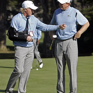 International Team captain Greg Norman, left, talks with Ernie Els, right, on the ninth green during a practice round at the Presidents Cup golf competition in San Francisco, Tuesday, Oct. 6, 2009. Play begins on Thursday.