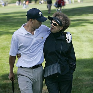 United States Presidents Cup team member Anthony Kim, left, walks with his mother, Miryoung Kim, during a practice round for the Presidents Cup golf competition Tuesday, Oct. 6, 2009, in San Francisco.