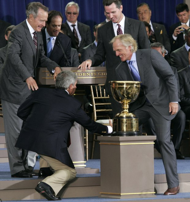 U.S. team captain Fred Couples, lower left, and International team captain Greg Norman joke as they shake hands during opening ceremonies for the Presidents Cup golf matches Wednesday, Oct. 7, 2009, in San Francisco. Former U.S. President George H.W. Bush, upper left, and San Francisco Mayor Gavin Newsom, behind Norman, look on.