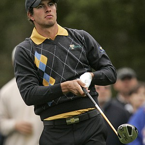 International Presidents Cup team player Adam Scott, from Australia, watches his drive on the third hole of his singles match against United States' Stewart Cink at the Presidents Cup at Harding Park Golf Course Sunday, Oct. 11, 2009, in San Francisco.