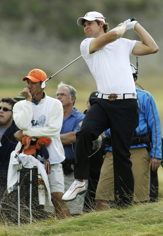 Peter Uihlein hits from the side of the 11th fairway in the quarterfinal round of the U.S. Amateur golf tournament, Friday, Aug. 27, 2010, at Chambers Bay in University Place, Wash.