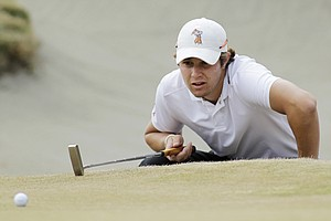 Peter Uihlein studies a putt on the 10th hole in the quarterfinal round of the U.S. Amateur golf tournament, Friday, Aug. 27, 2010, at Chambers Bay in University Place, Wash.