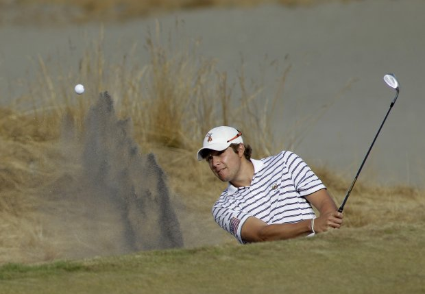 Peter Uihlein hits from the bunker on the fourth hole during a semifinal match of the U.S. Amateur golf tournament, Saturday, Aug. 28, 2010, at Chambers Bay in University Place, Wash. Uihlein will face David Chung in the final match on Sunday.