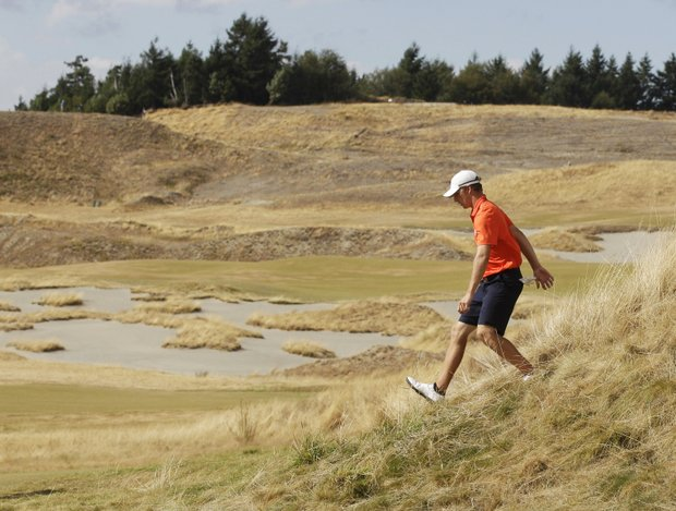 Morgan Hoffmann walks down from a hill after scouting his fairway shot on the seventh hole in the third round of the U.S. Amateur Open golf tournament, Thursday, Aug. 26, 2010, at Chambers Bay in University Place, Wash.