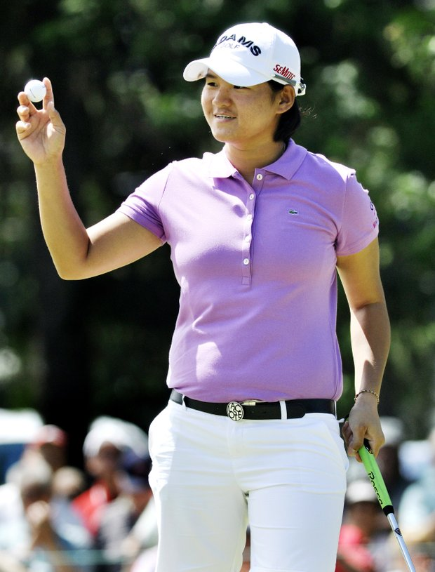 Yani Tseng, of Taiwan, acknowledges the gallery after making birdie on the ninth hole during the first round of the Wegmans LPGA Championship golf tournament in Pittsford, N.Y., Thursday, June 23, 2011.