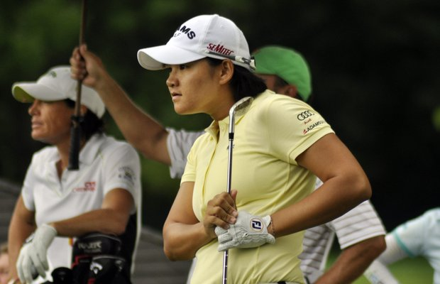 Yani Tseng,of Taiwan, watches her shot on the 15th hole during the second round of the Wegmans LPGA Championship golf tournament in Pittsford, N.Y., Friday, June 24, 2011.