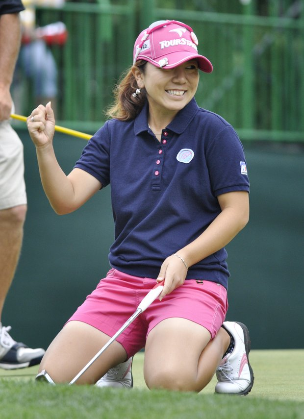Mika Miyazato, of Japan, reacts after making birdie on the ninth hole during the third round of the Wegmans LPGA Championship golf tournament in Pittsford, N.Y., Saturday, June 25, 2011.