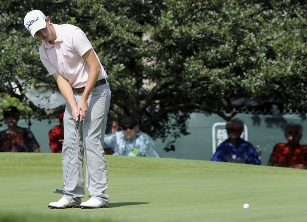 Amateur Patrick Cantlay watches his birdie putt on the 9th hole during the third round of the Travelers Championship golf tournament in Cromwell, Conn., on Saturday, June 25, 2011.