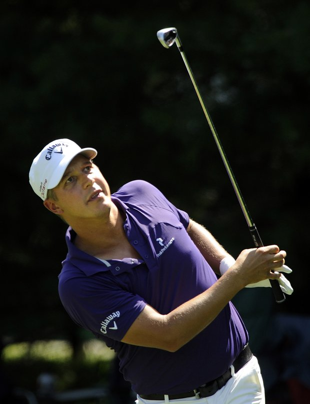 Frederik Jacobson, from Sweden, eyes his tee shot on the 8th hole during the third round of the Travelers Championship golf tournament in Cromwell, Conn., on Saturday, June 25, 2011. Jacobson finished the round 7-under par and leads the tournament at 16-under par.