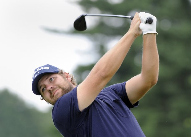 Ryan Moore watches his drive on the second hole during the final round of the Travelers Championship golf tournament in Cromwell, Conn., on Sunday, June 26, 2011.