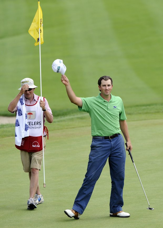 Michael Thompson, right, acknowledges the gallery after making a birdie on the 18th hole during the final round of the Travelers Championship golf tournament in Cromwell, Conn., on Sunday, June 26, 2011. Thompson finsihed the final round with an 18-under par 262.
