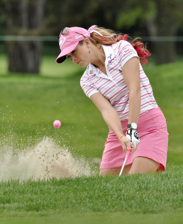 Paula Creamer hits out of a greenside bunker on the first hole during the final round of the Wegmans LPGA Championship golf tournament in Pittsford, N.Y., Sunday, June 26, 2011.