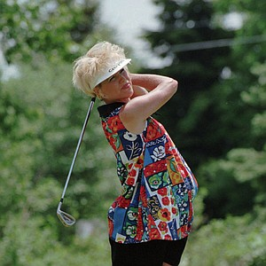 Laura Baugh of Orlando, Fla., makes her shot on the second tee in the Oldsmobile Classic LPGA tournament in East Lansing, Mich., Saturday, June 7, 1997.
