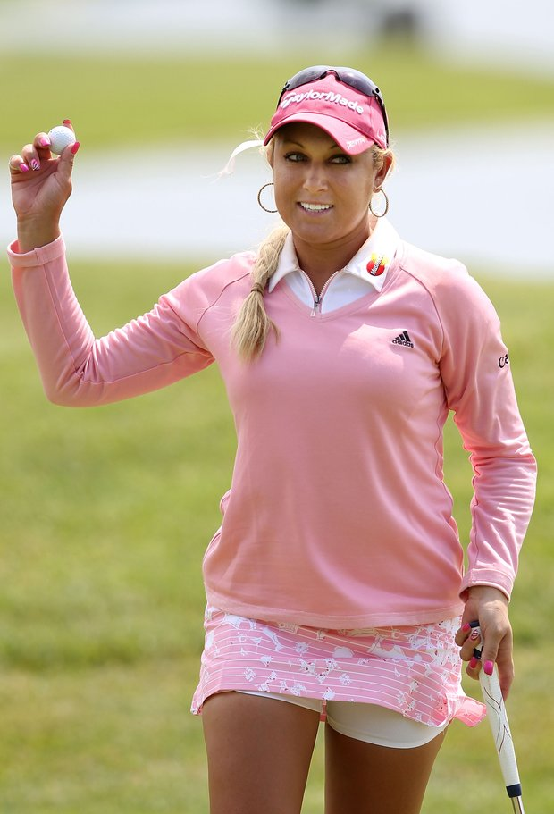 Natalie Gulbis acknowledges the crowd on the ninth hole green during the second round of the LPGA State Farm Classic at Panther Creek Country Club on June 10, 2011 in Springfield, Illinois.
