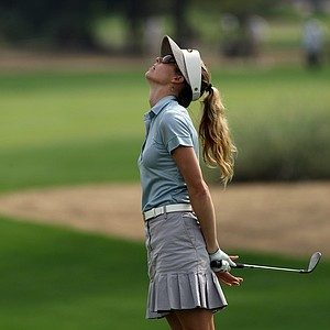 Anna Rawson of Australia plays her third shot at the 12th hole during the final round of the Dubai Ladies Masters, on the Majilis Course at the Emirates Golf Club on December 12, 2009 in Dubai, United Arab Emirates.