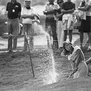 Jan Stephenson blasts out of a sand trap on the 18th hole of Calabasas Park country club during the opening round of the Carlton Golf Tournament in Calabasas, Ca., Thursday, Sept. 23, 1976. Stephenson's shot landed about 5 feet past the pin and she dropped the putt for a birdie 4.