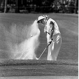 Australia's Jan Stephenson blasts from the trap on the 12th green on the way to taking the first round lead in the Women's International Golf Tournament at Hilton Head Island, S.C., May 5, 1978. Stephenson shot a four-under-par 68.