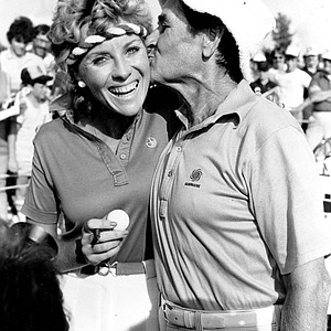 Jan Stephenson gets a kiss from her father Frank on Father's Day after Jan won the LPGA Ladies Keystone Open at Hershey, Pa., Sunday, June 20, 1982. Frank, of Sydney, Australia, caddied for his daughter throughout the 3-day 54-hole tournament which Jan won with a 5-under par 211 and first prize purse of $30,000. Stephenson also won the LPGA Open last week.