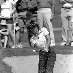 Jan Stephenson of Ft. Worth, Texas, appears to be scooping the ball out of the sand trap at the fourth hole, at Mission Hills Country Club, in the Nabisco-Dinah Shore Invitational LPGA Tournament in Rancho Mirage, Calif., April 1, 1983.