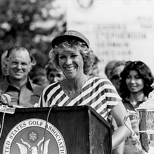 Jan Stephenson smiles as she receives the trophy for her victory at the U.S. Women's Open in Tulsa, Okla., Sunday, Aug. 1, 1983. Stephenson captured the title and the $32,000 first prize with her six-over-par 290 for the 72 holes.