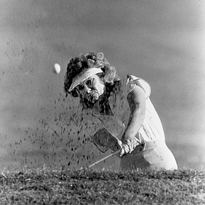 LPGA golfer Jan Stephenson blasts out of a sand trap on the 16th hole during the opening day round in the Samaritan Turquoise Classic golf tournament in Pheonix, Ariz., Feb. 20, 1986.