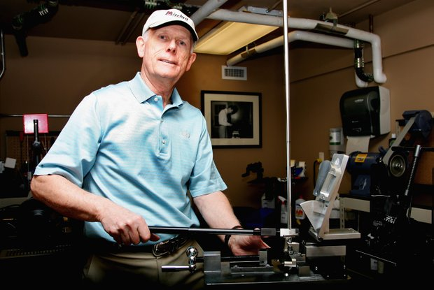 Ed Mitchell works in the club repair room during the final round of the 2009 Masters Tournament at Augusta National Golf Club on April 12, 2009 in Augusta, Georgia.