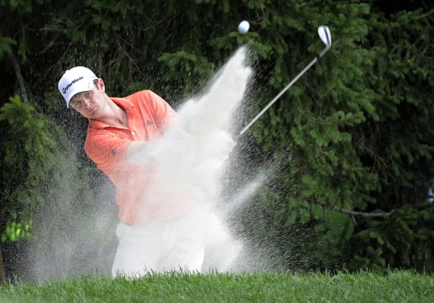 Defending champion Justin Rose, of England, hits out of a bunker on the chipping green while practicing for the AT&T National golf tournament at Aronimink Golf Club, Wednesday, June 29, 2011, in Newtown Square, Pa.