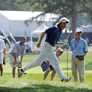 Tim Petrovic runs as he watches his shot after hitting from the rough on the ninth hole during the opening round of the AT&T National golf tournament at Aronimink Golf Club, Thursday, June 30, 2011, in Newtown Square, Pa.