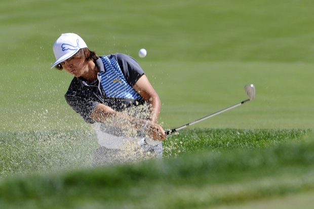 Rickie Fowler hits out of a bunker on the 12th green during the second round of the AT&T National golf tournament at Aronimink Golf Club, Friday, July 1, 2011, in Newtown Square, Pa.