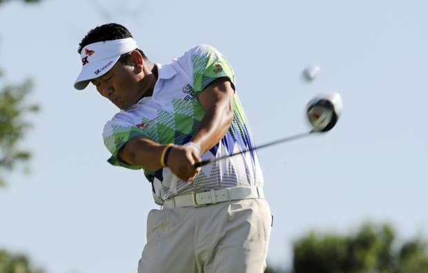 K.J. Choi of South Korea tees off on the 12th hole during the second round of the AT&T National golf tournament at Aronimink Golf Club, Friday, July 1, 2011, in Newtown Square, Pa.