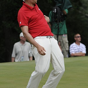 Jeff Overton reacts to a missed putt on the second hole during the final round of the AT&T National golf tournament at Aronimink Golf Club, Sunday, July 3, 2011, in Newtown Square, Pa.