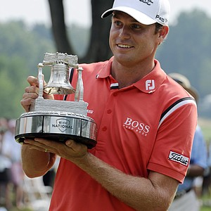 Nick Watney holds the trophy after winning the AT&T National golf tournament at Aronimink Golf Club, Sunday, July 3, 2011, in Newtown Square, Pa.