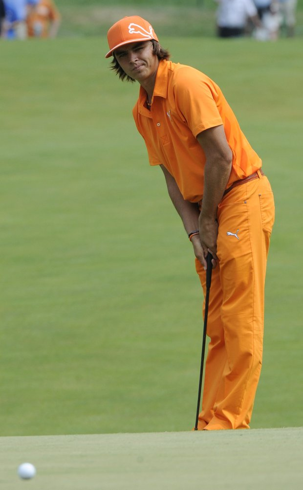 Rickie Fowler reacts to a missed putt on the 14th hole during the final round of the AT&T National golf tournament at Aronimink Golf Club, Sunday, July 3, 2011, in Newtown Square, Pa.