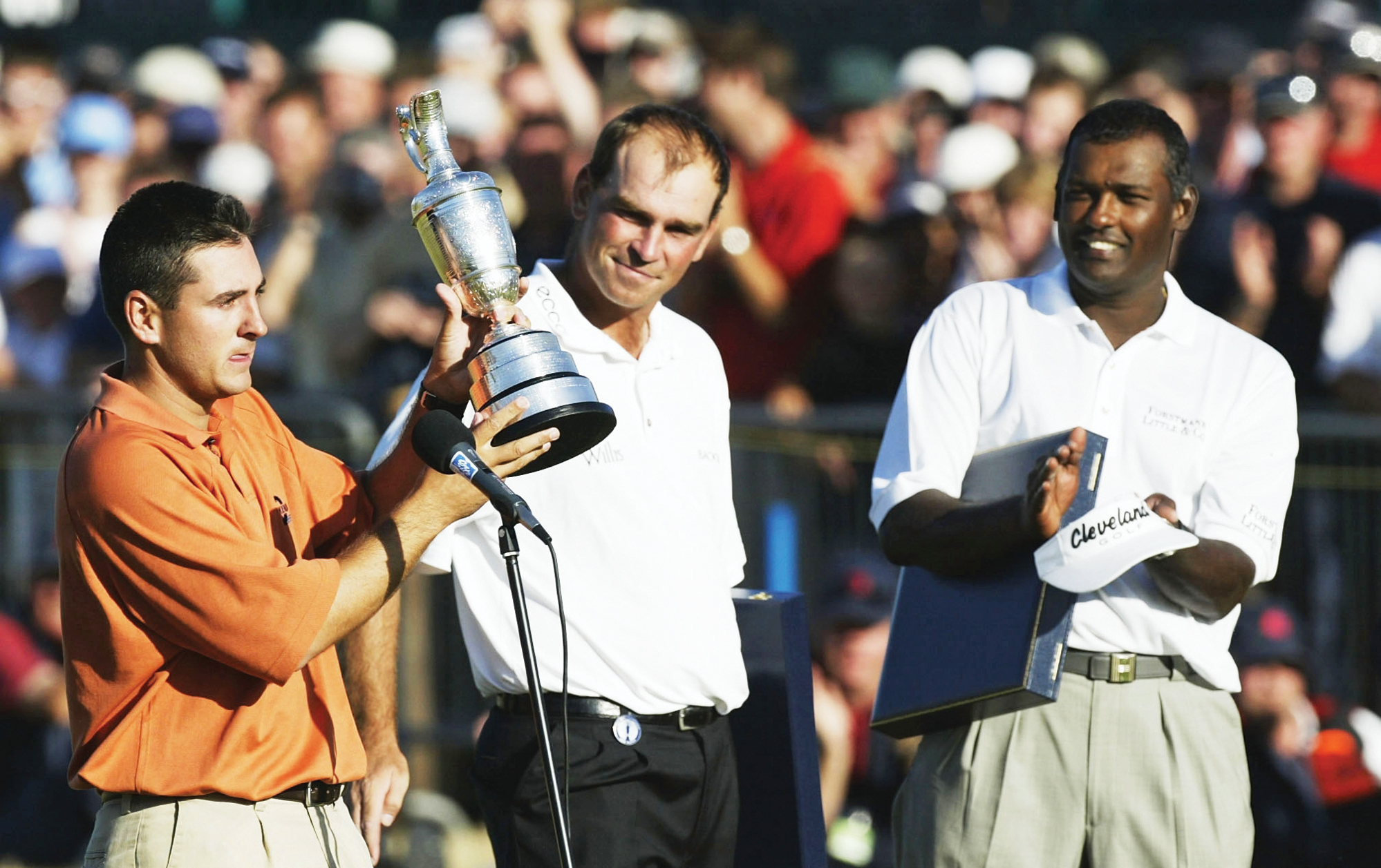 As Ben Curtis (left) addresses the gallery after his victory, Thomas Bjorn (center) and Vijay Singh were left to ponder the jug that got away.