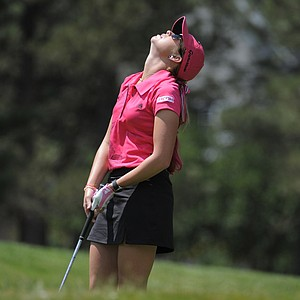 Paula Creamer reacts to a bad tee shot on the 12th hole during the weather delayed first round of the Women's U.S. Open golf tournament at the Broadmoor Golf Club on Friday, July 8, 2011, in Colorado Springs, Colo.