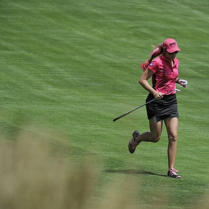 Paula Creamer runs up the 11th fairway to check her line to the hole as she finishes the weather delayed first round of the Women's U.S. Open golf tournament at the Broadmoor Golf Club on Friday, July 8, 2011, in Colorado Springs, Colo.