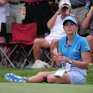 Paula Creamer sits on the 18th green and looks at her course notes during the second round of the Women's U.S. Open golf tournament at the Broadmoor Golf Club on Friday, July 8, 2011, in Colorado Springs, Colo.