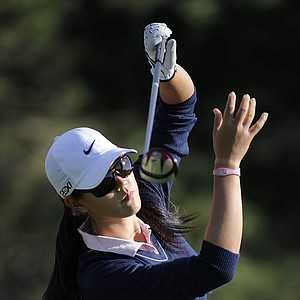 Michelle Wie loses the grip on her driver as she tees off on the second hole as she finishes the delayed second round of the Women's U.S. Open golf tournament at the Broadmoor Golf Club on Saturday, July 9, 2011, in Colorado Springs, Colo.