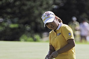 Mika Miyazato of Japan eighth hole as she finishes the delayed second round of the Women's U.S. Open golf tournament at the Broadmoor Golf Club on Saturday, July 9, 2011, in Colorado Springs, Colo.