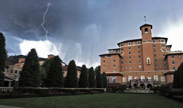 Lightning flashes in the sky over the Broadmoor Resort where the the third round of the Women's U.S. Open golf tournament at the Broadmoor Golf Club has be delayed because of weather on Saturday, July 9, 2011, in Colorado Springs, Colo.