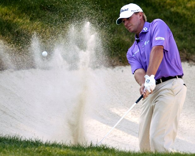 Steve Stricker hits out of the bunker on the 18th hole during the third round of the John Deere Classic golf tournament at TPC Deere Run in Silvis, Ill., on Saturday, July 9, 2011.