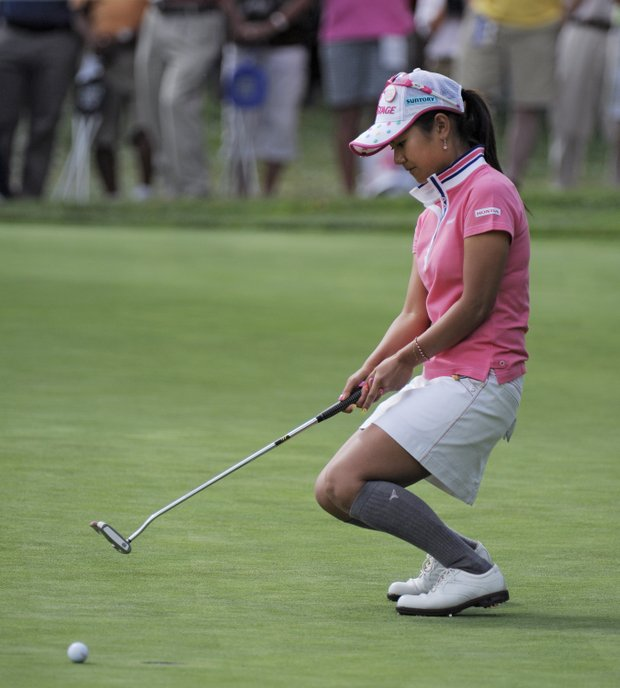 Ai Miyazato of Japan reacts as she misses a birdie putt on the fifth hole during the delayed third round of the Women's U.S. Open golf tournament at the Broadmoor Golf Club on Sunday, July 10, 2011, in Colorado Springs, Colo.