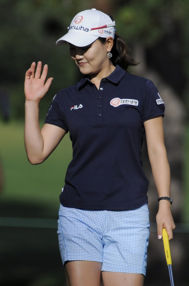 So Yeon Ryu of South Korea waves after making par on the second hole during the delayed third round of the Women's U.S. Open golf tournament at the Broadmoor Golf Club on Sunday, July 10, 2011, in Colorado Springs, Colo.