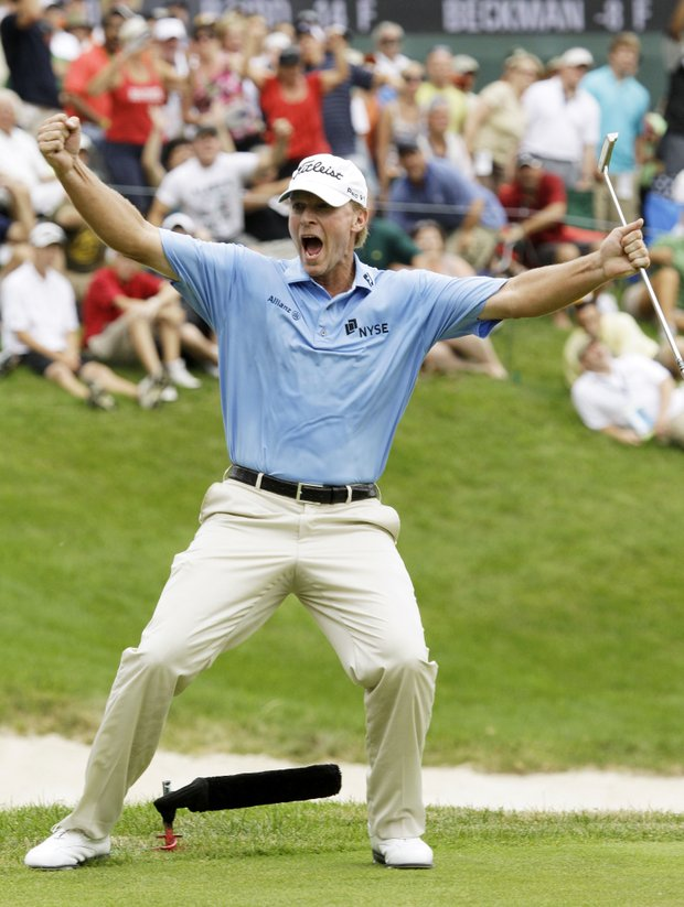 Steve Stricker reacts after making a birdie putt on the 18th green to win the John Deere Classic golf tournament at TPC Deere Run on Sunday, July 10, 2011, in Silvis, Ill.